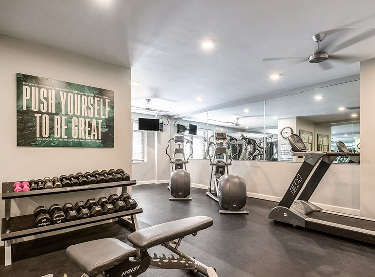 Fully equipped fitness center at The Georgian Apartments in New Orleans