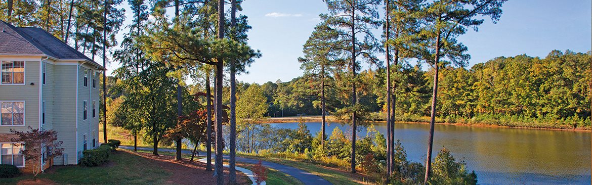 Apartments in Cary with lake views and tree-lined paths