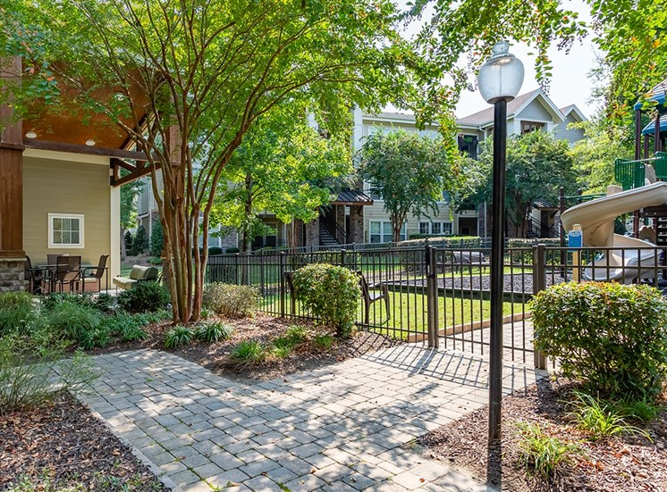 Perry Point apartments courtyard and playground in Raleigh, North Carolina