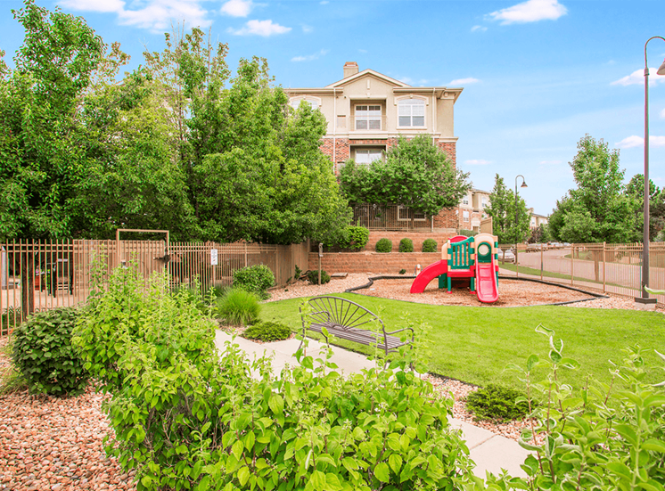 Retreat at City Center apartments fenced playground in Aurora, Colorado