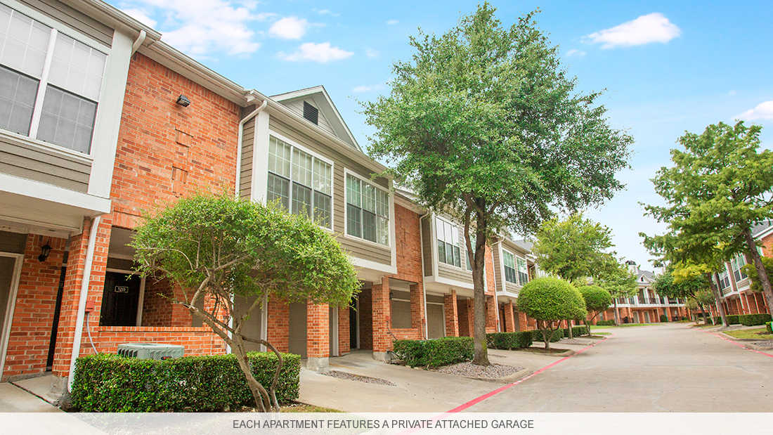 Garland apartment complex with private garages and driveways