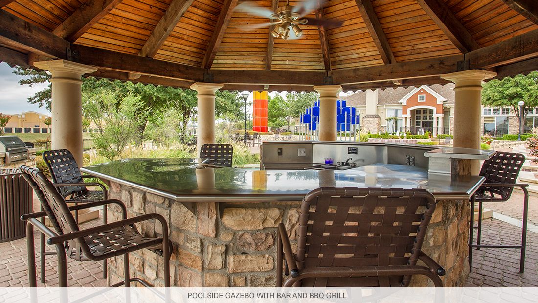 Irving apartment complex with poolside gazebo featuring bar and BBQ grill