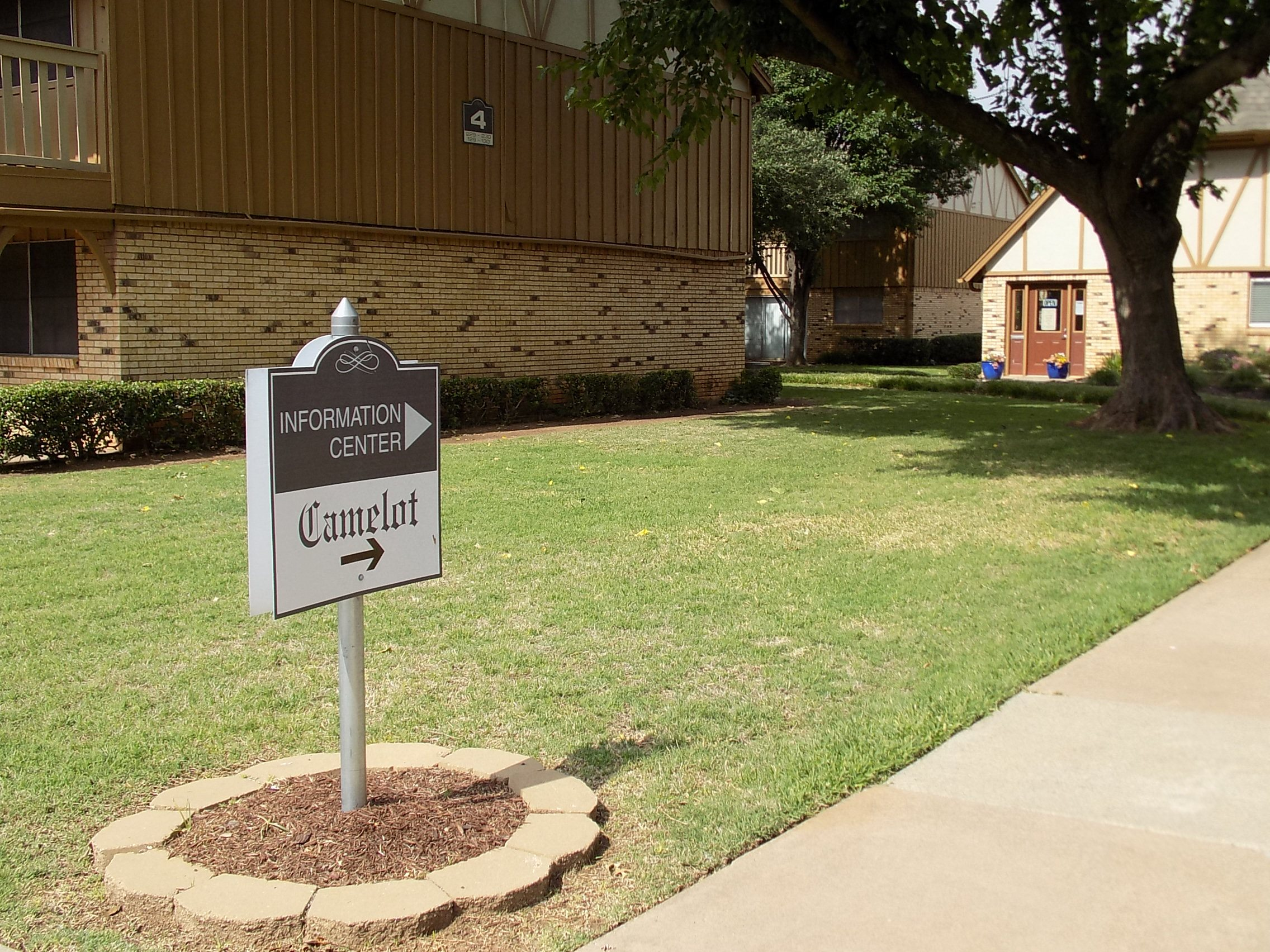 office sign at Camelot Apartments in Wichita Falls TX