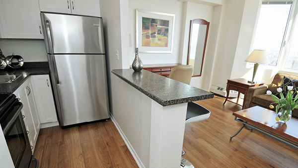 Kitchen includes microwave, stove, refrigerator, coffee maker and kettle