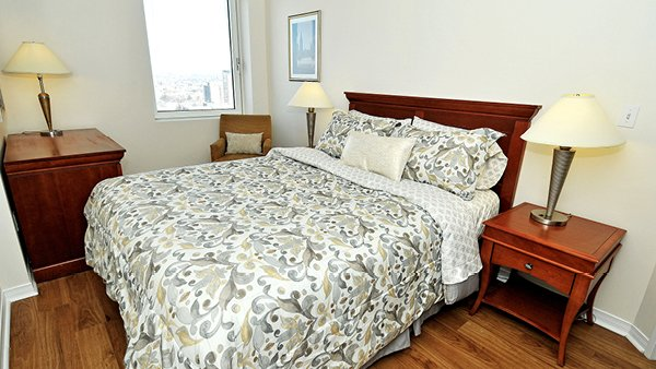 Bedrooms include queen bed, end tables and dresser