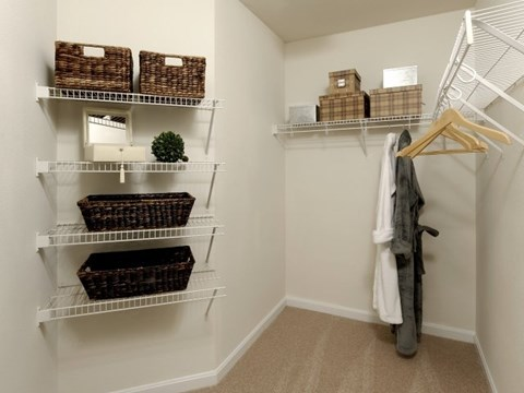 Walk-in closet space, with shelves