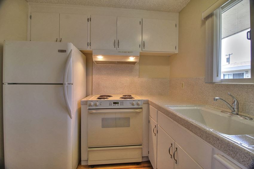 Kitchen With White Cabinetry And Appliances at Ranchero Plaza, San Jose, CA, 95117