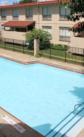 Relax by the pool at Cedar Trace Apartments in Maryland Heights