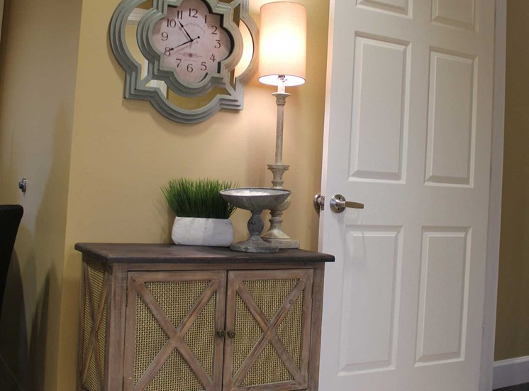 side table with lamp by front door