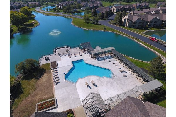 Oversized pool with sun deck overlooking the lake