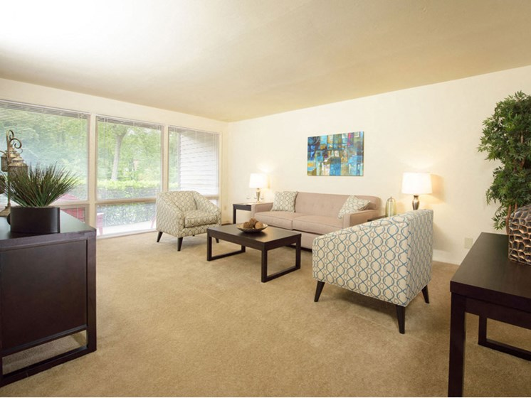 Spacious Living Room With Plush Carpeting at Brook View Apartments Baltimore MD 21209