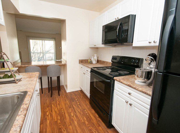 McDonogh renovated kitchen with breakfast bar and black appliances