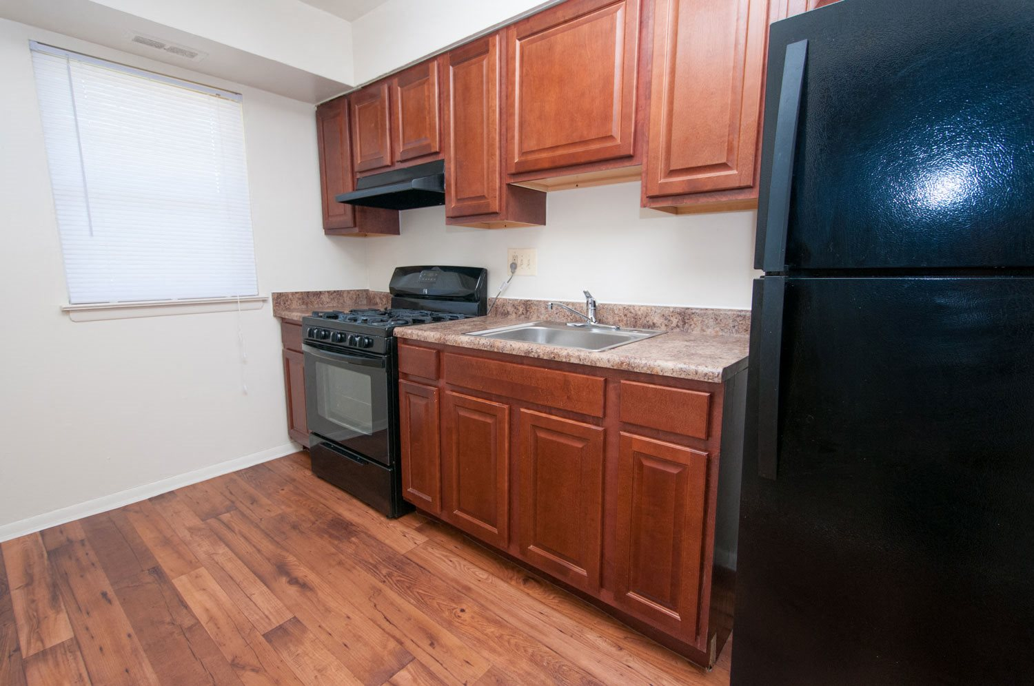 Spacious Kitchen with Pantry Cabinet at Northwood Ridge Apartments and Townhomes, Baltimore, MD