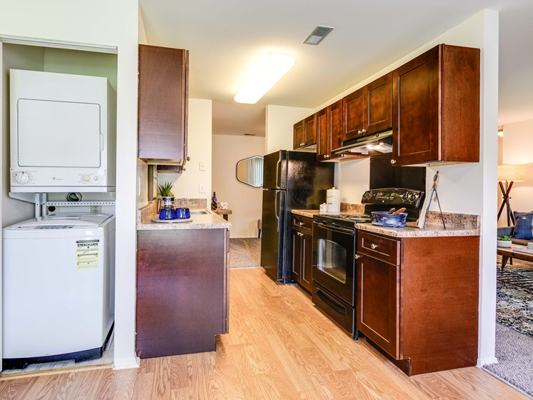 Washer And Dryer Attached Along With Kitchen Area at Westwinds Apartments, Annapolis, Maryland