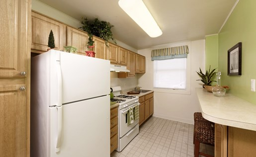 Fully equipped kitchen at Oaklee Village and Leeds Avenue Apartments, Baltimore, MD