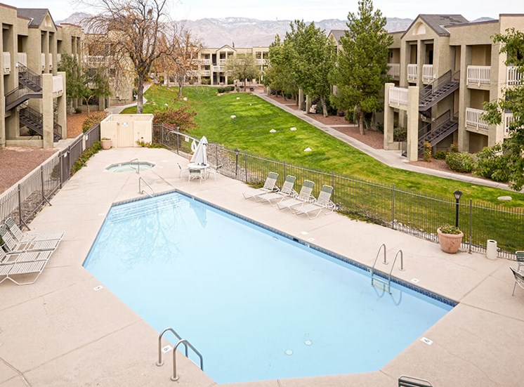 Aerial view of resort style pool of Pavilions at Pantano in Tucson, AZ, For Rent. Now leasing 1, 2 and 3 bedroom apartments.