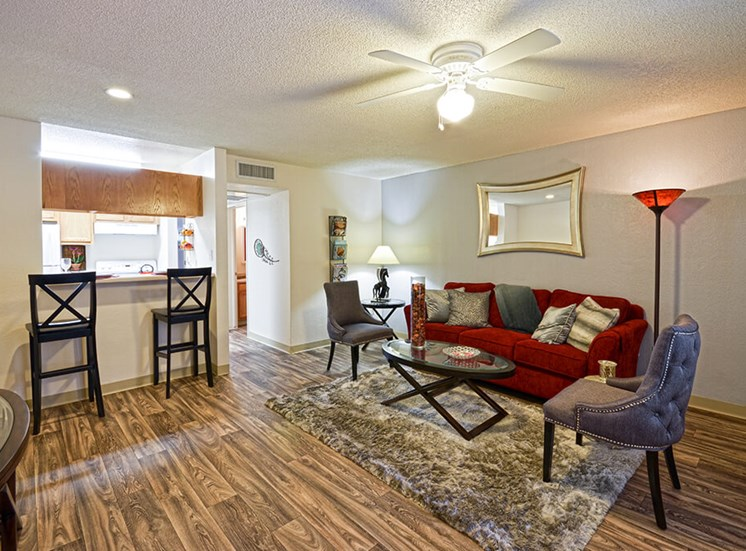 Vinyl wood flooring in open Kitchen living room of Pavilions at Pantano in Tucson, AZ, For Rent. Now available leasing 1, 2 and 3 bedroom apartments.