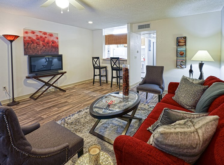 Vinyl Wood flooring in living spaces with counter bar of Pavilions at Pantano in Tucson, AZ, For Rent. Now leasing 1, 2 and 3 bedroom apartments.