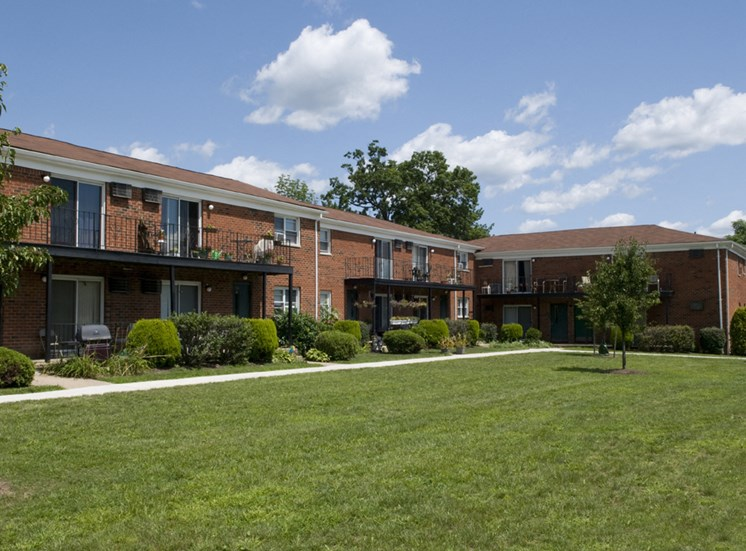 Beautiful landscaped courtyards behind apartment building at Troy Hills Village apartments in NJ