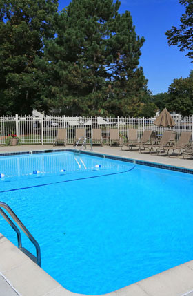 Relax by the Outdoor Pool at Castle Pointe Apartments in East Lansing