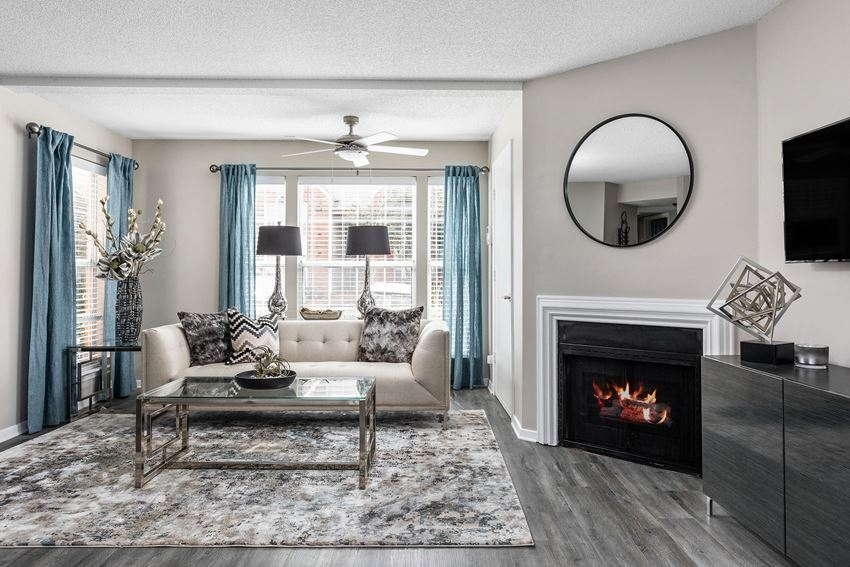 Gorgeous apartment living room with hardwood flooring and a fireplace