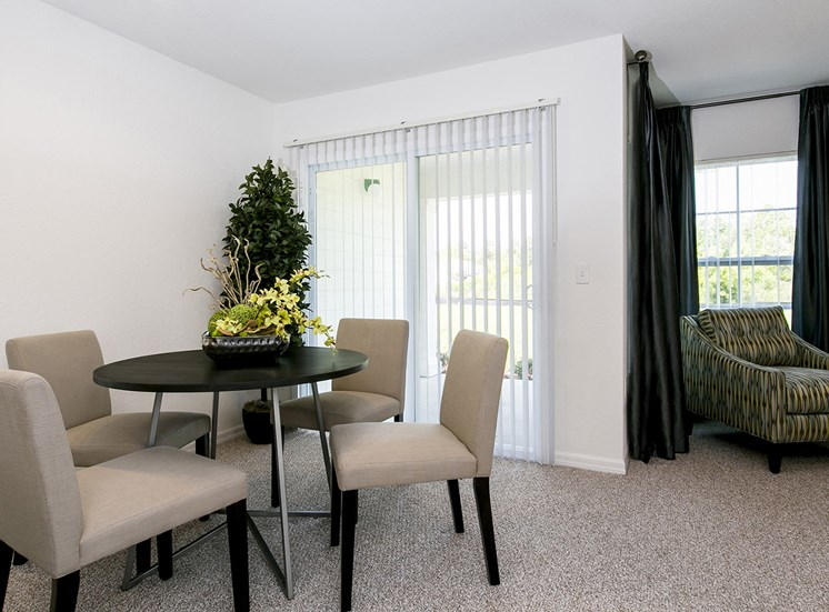 Dean Woods Place Apartments for rent in Orlando, FL. Make this community your new home or visit other ConcordRENTS communities at ConcordRENTS.com. Dining room