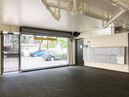 Kewalo Apartments garage door and mail boxes