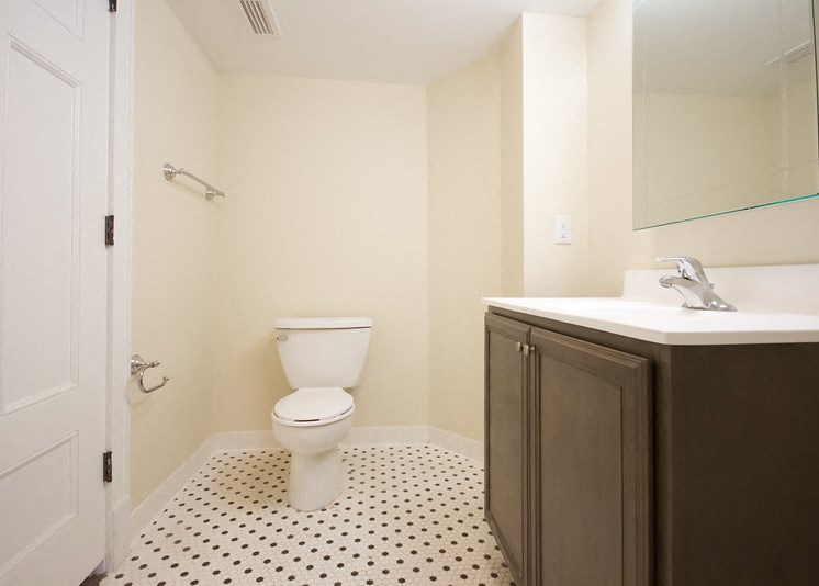 Bathroom with upgraded tiles and cabinets