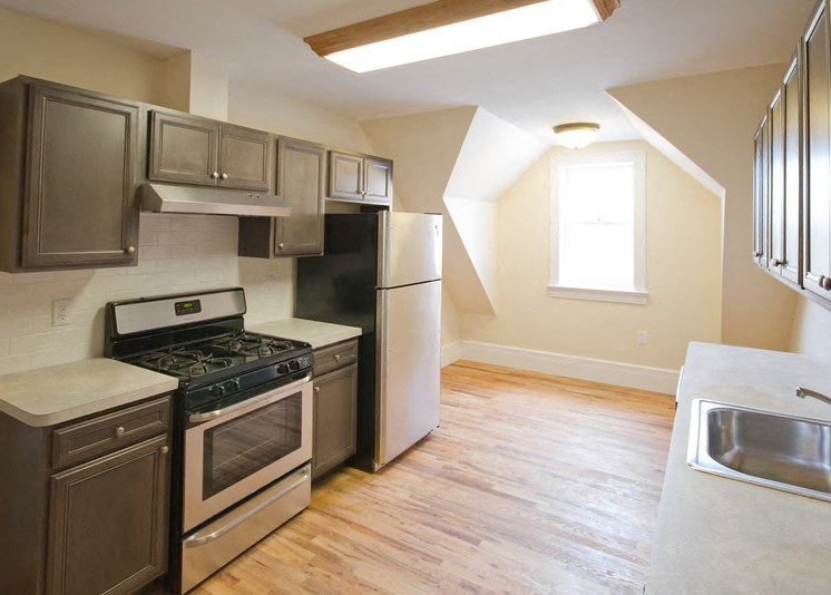 Kitchen with updated refrigerate and appliances