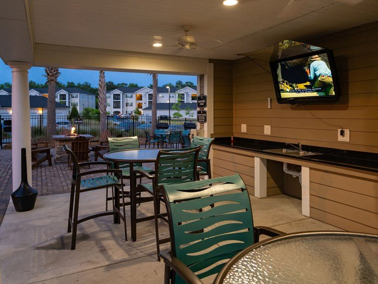 Picnic Grilling Area with TV at Abberly Crossing Apartment Homes by HHHunt, Ladson, 29456