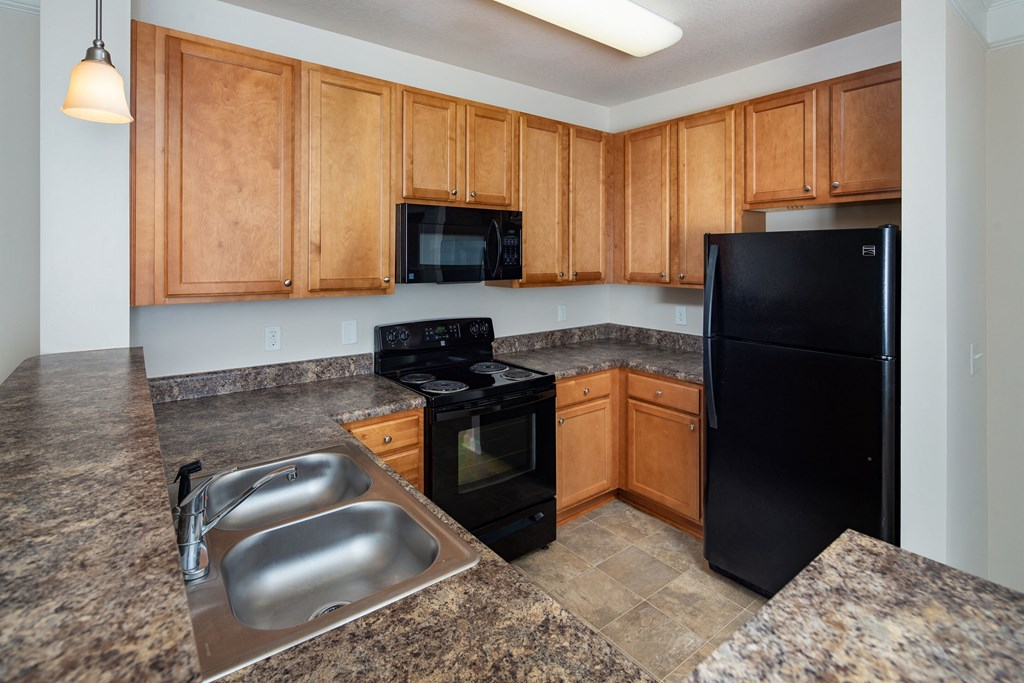 Modern Kitchen With Black Appliances at Abberly Crossing Apartment Homes by HHHunt, Ladson, SC