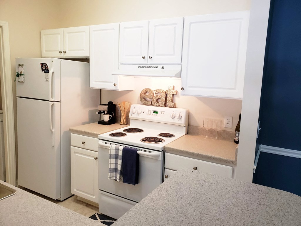 Kitchen With White Cabinetry And Appliances at Abberly Grove Apartment Homes by HHHunt, Raleigh