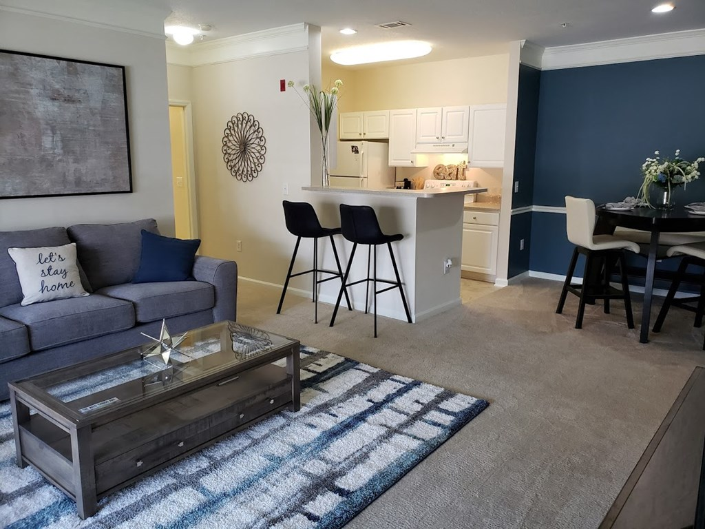 LIVING ROOM WITH KITCHEN at Abberly Grove Apartment Homes by HHHunt, Raleigh, 27610