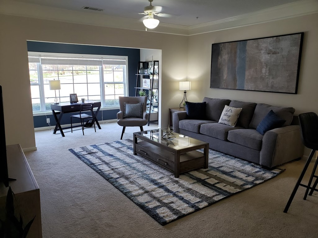 LIVING ROOM WITH SUNROOM at Abberly Grove Apartment Homes by HHHunt, Raleigh, NC