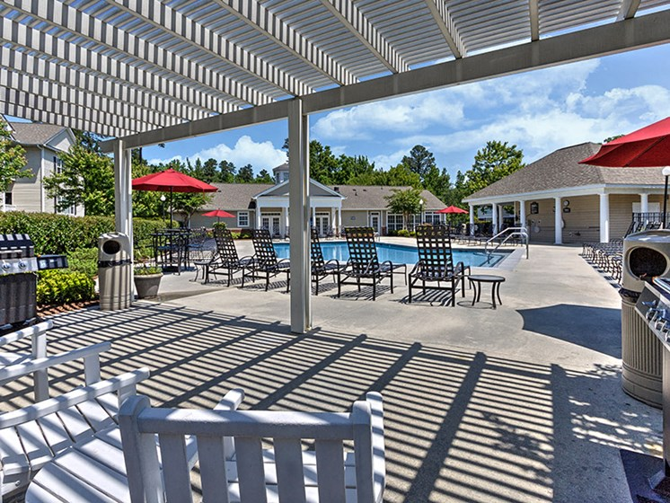 Bask in the sun over lunch at Abberly Grove Apartment Homes, Raleigh