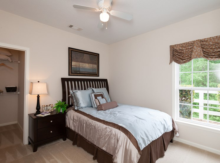 Wood-look flooring extends to bedroom at Abberly Grove Apartment Homes, North Carolina, 27610