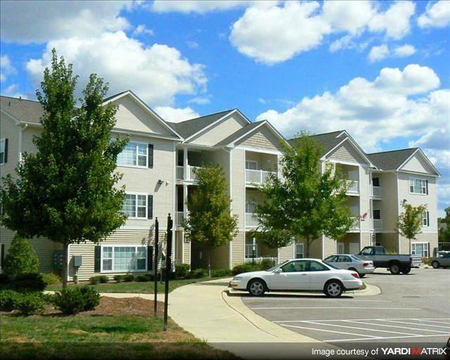 Lush landscaping and tranquil wood settings at Abberly Grove Apartment Homes, North Carolina