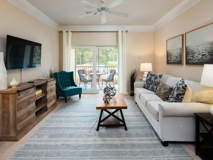 Living Room With Private Balcony at Abberly Pointe Apartment Homes by HHHunt, Beaufort, 29935