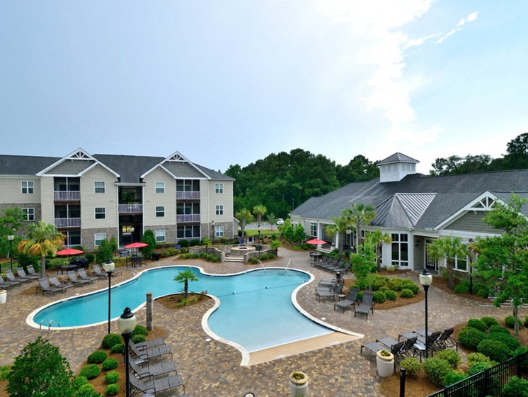 Pool Side Relaxing Area at Abberly Pointe Apartment Homes by HHHunt, South Carolina, 29935