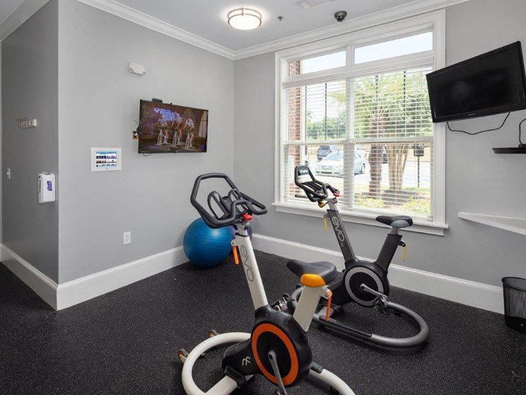 Free Weights And Cardio Equipment at Abberly Village Apartment Homes by HHHunt, West Columbia