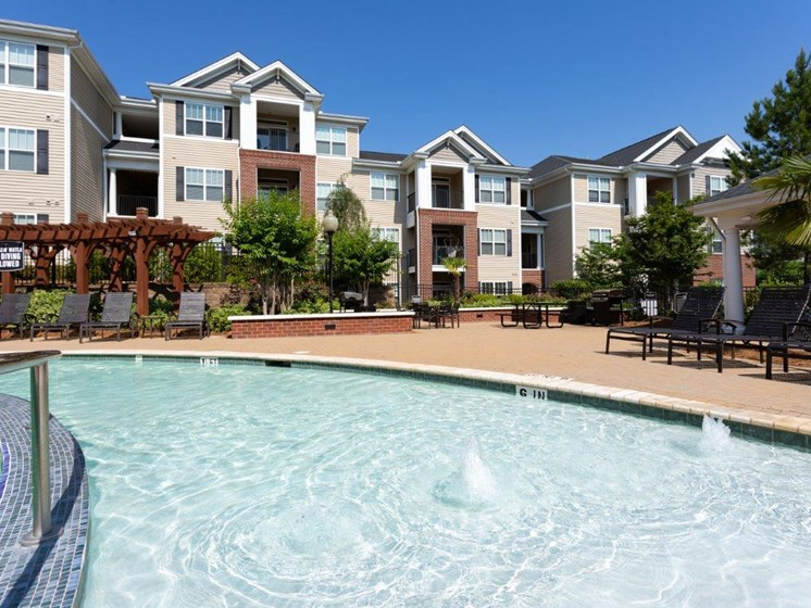 Swimming Pool With Sparkling Water at Abberly Village Apartment Homes by HHHunt, South Carolina