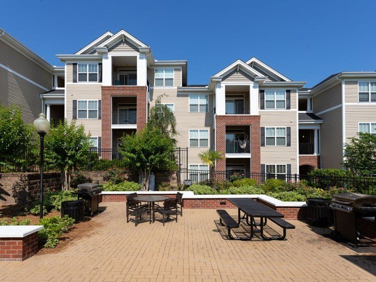 Garden Courtyard With Grills And Fireplace at Abberly Village Apartment Homes by HHHunt, South Carolina, 29169