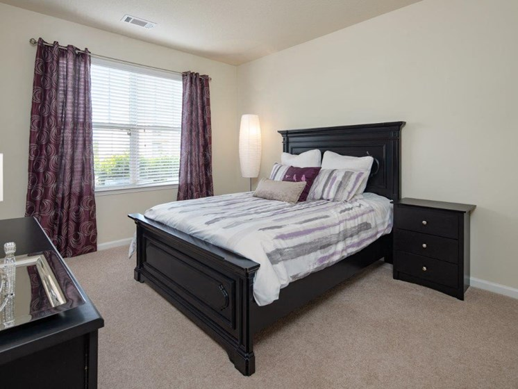 Spacious Bedroom With Comfortable Bed at Abberly Village Apartment Homes, South Carolina, 29169