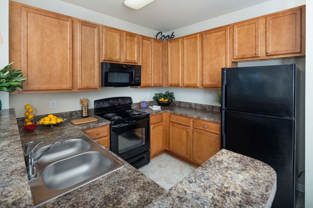 Gourmet Kitchen With Island at Abberly Village Apartment Homes by HHHunt, South Carolina, 29169