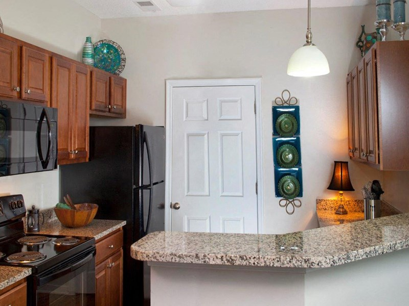 Granite Countertops In Kitchen at Abberly Twin Hickory Apartment Homes by HHHunt, Virginia