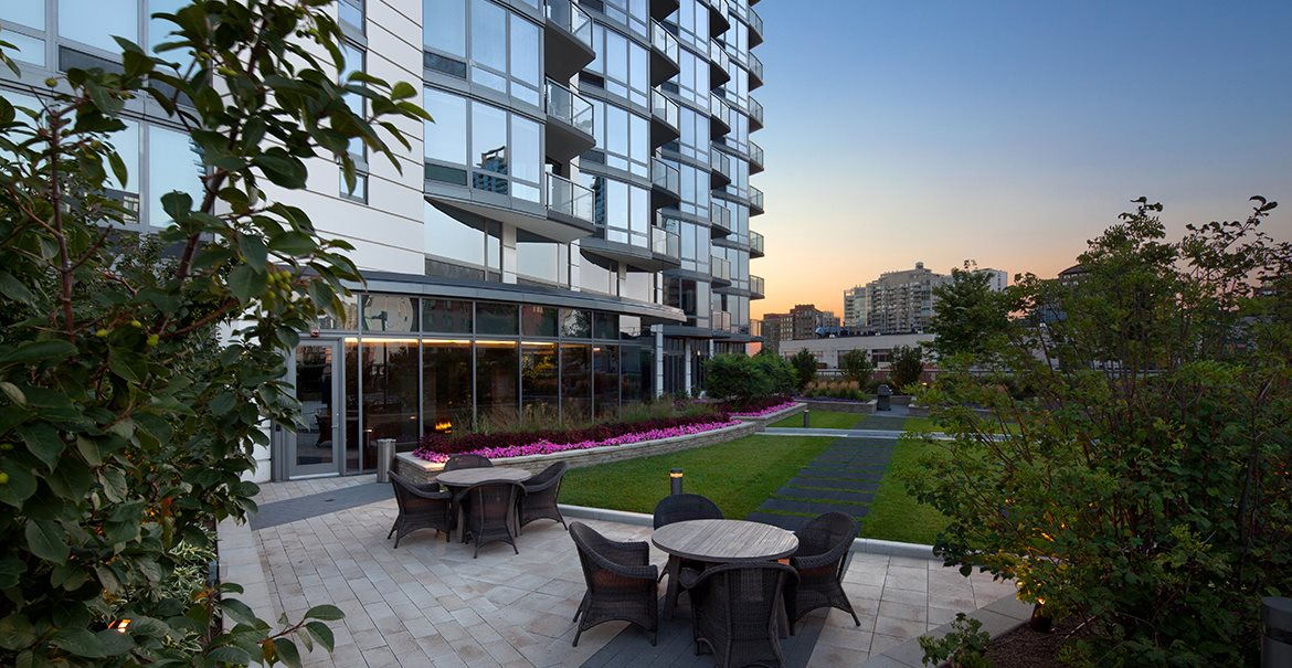 Hubbard Place offers residents private outdoor living spaces with grills.