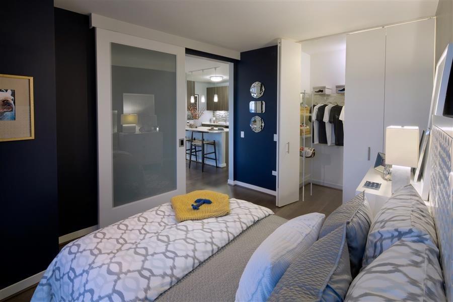 Generous walk through closets at a Chicago, IL, luxury apartment.