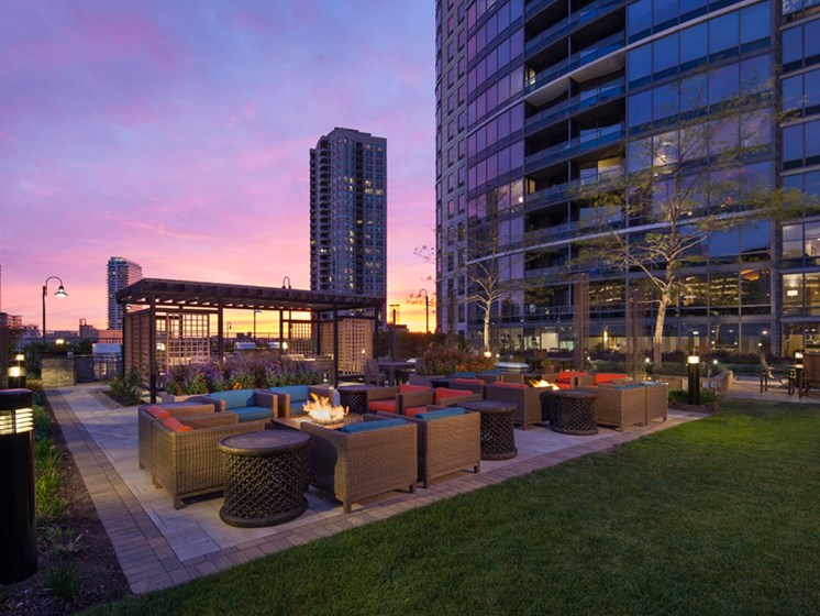 Outdoor fire pits, seating area, and gazebo at sunset