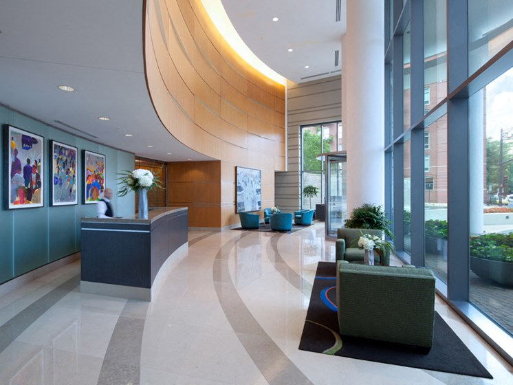 Entrance lobby with desk and large windows at Kingsbury Plaza