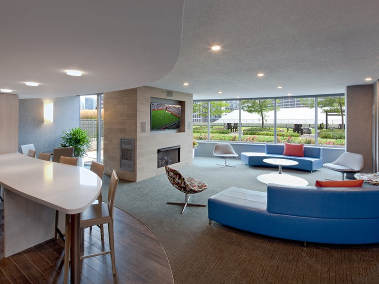 Resident Social lounge with flatscreen television seating and large windows
